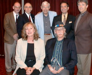 Dennis receives the Marlowe Award for Lifetime Achievement, 2002. Back row, left to right, Tom Nolan, author Robert Levinson, critic Charles Champlin, authors Jonathan Kellerman and Dick Lochte. Front row, Gayle & Dennis Lynds