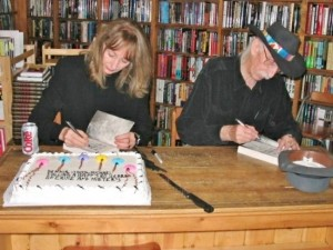Gayle & Dennis signing their books, celebrating his 80th birthday, 2004